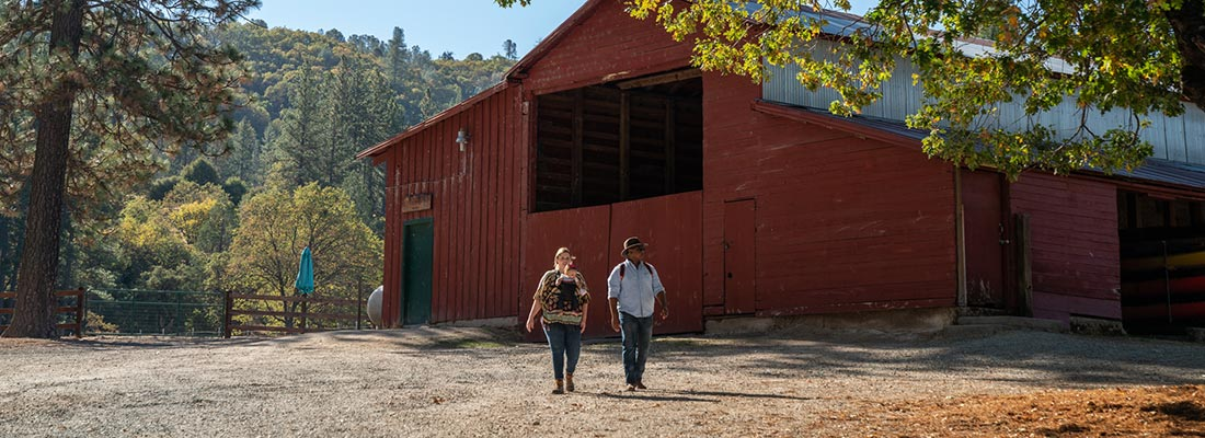couple on grounds by barn